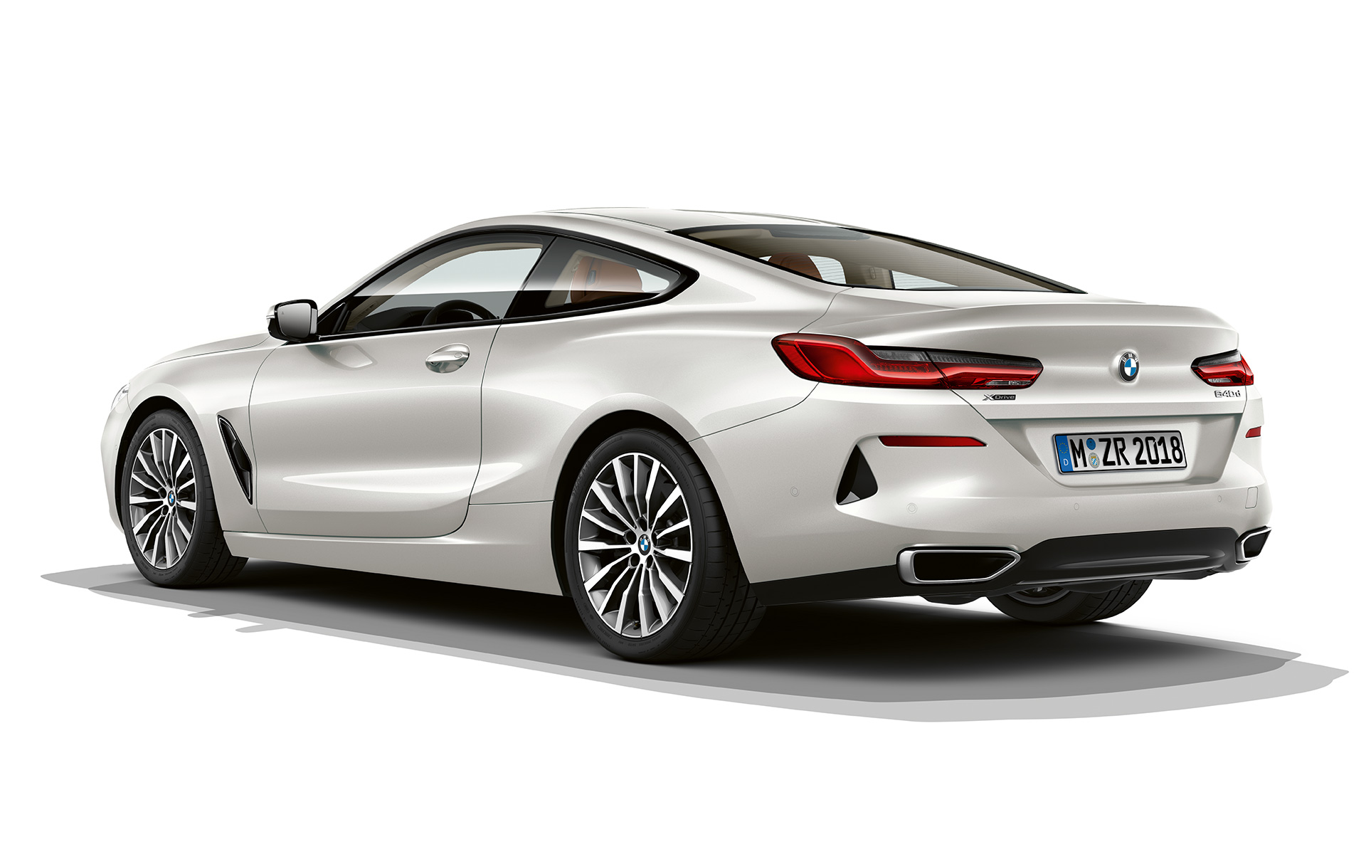 Still shot of the BMW 8 Series Coupé in Mineral White metallic against a white background.