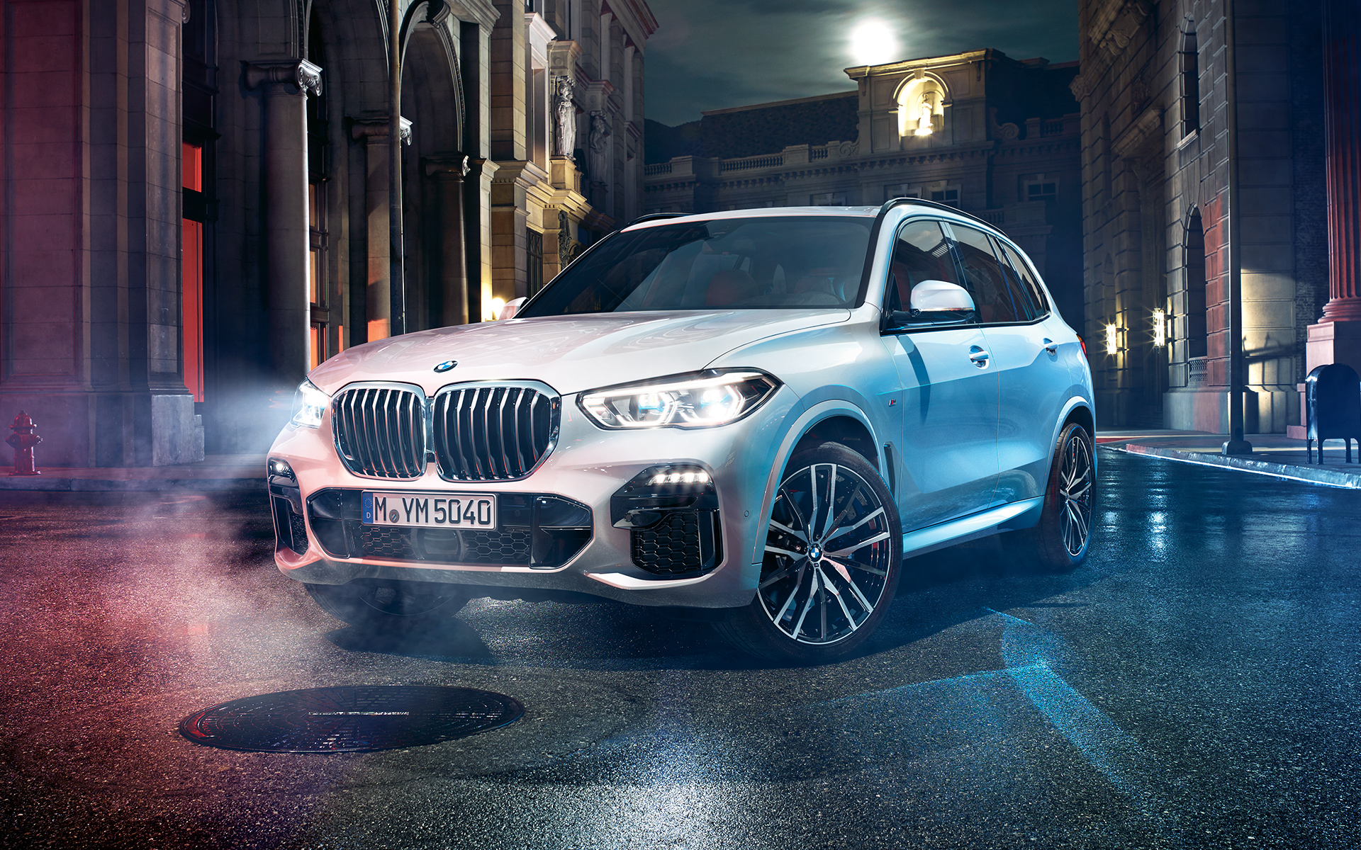 Front shot of the BMW X5 at night in an urban setting