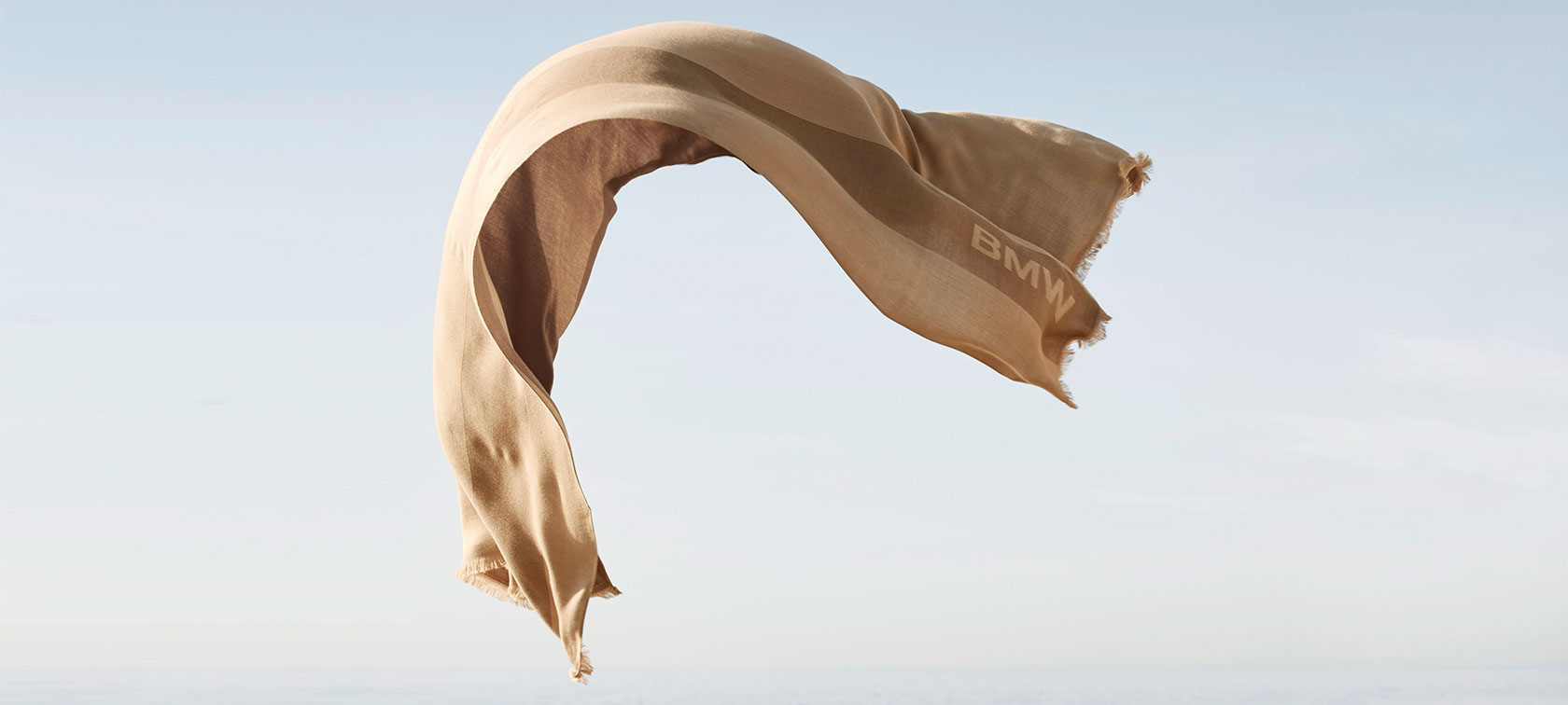 The BMW Summer Scarf is fluttering in the wind.